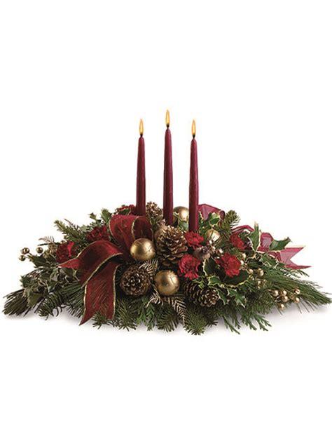 composizioni con candele centrotavola natalizio con pigne e candele a domicilio