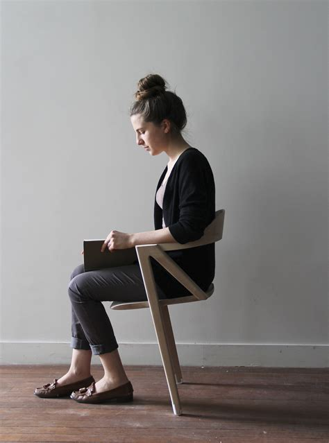 Person Sitting In Chair by A Two Legged Chair Encourages Sitting To Move And