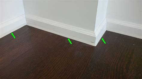 how to put caulking around a bathtub floor molding caulk image titled 4 dscn6961 step 4 caulking put along baseboard to
