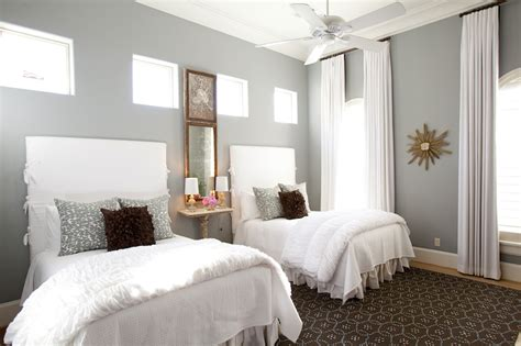 gray walls white curtains twin slipcovered headboards transitional bedroom