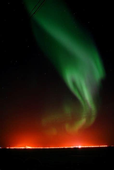 northern lights sun northern lights in barrow alaska under the midnight sun