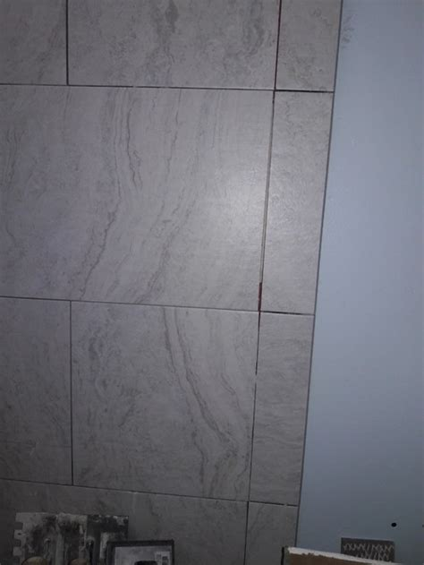 shower tile grout lines crooked and lack of mortar thinset