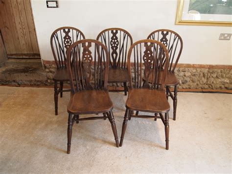 wheeled dining chairs amish wheel fiddleback dining room