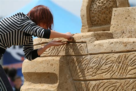 for a at work file sedina sand statue sculptor at work jpg