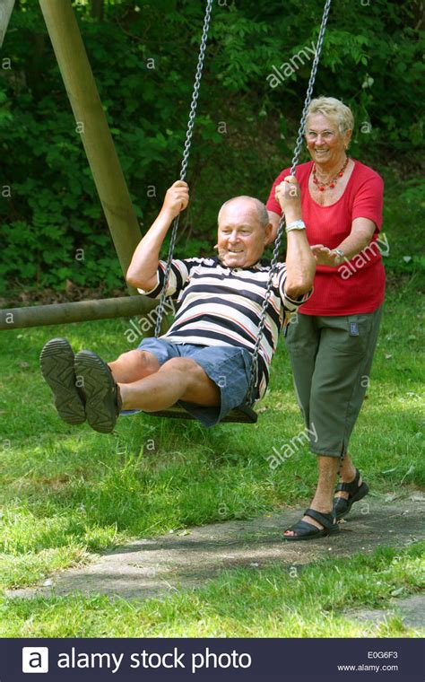 person on swing laughing boss on swing 60 old old old woman old