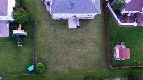 Backyard Subdivision by Aerial View Houses In Residential Suburban Neighborhood