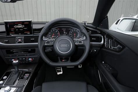 Rs7 Interior by Bmw M6 Gran Coupe Vs Audi Rs7 Sportback Auto Express