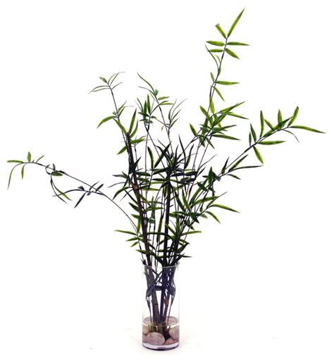 bamboo branches with river rocks in glass vase
