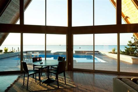 beautiful beach house design blending glass walls