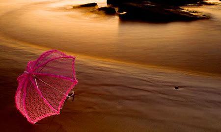 pink umbrella wallpaper pink umbrella on the beach beaches nature background