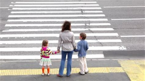 children cross  road carefully
