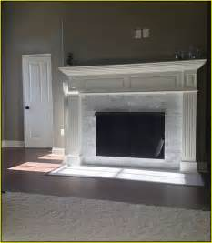 fireplace marble tile carrara marble tile fireplace surround home design ideas