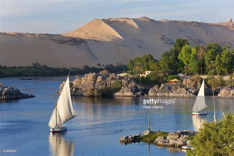 felucca sailboats on river nile aswan egypt stock photo - Nile Sailboats