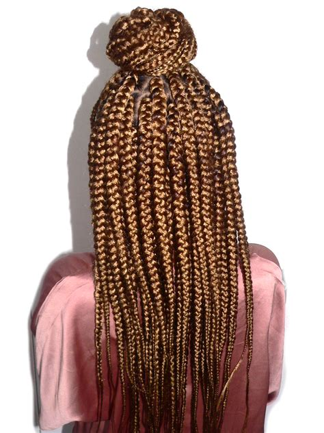 cornrows with box braids in the back ramia half cornrow bun half box braids back kids with curls