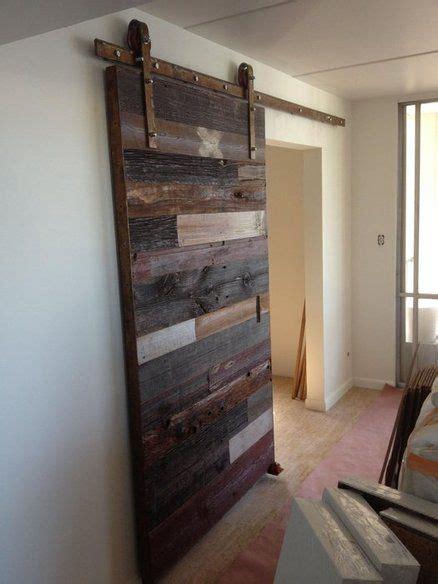 contemporary reclaimed barn wood sliding door home