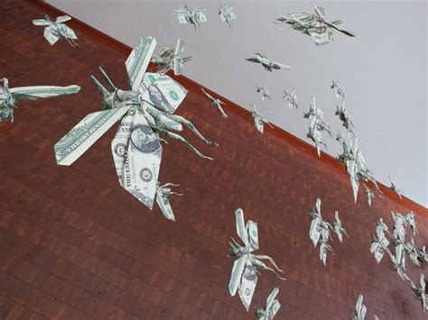 Flying Origami - sipho mabona s swarm of flying money origami locusts yatzer