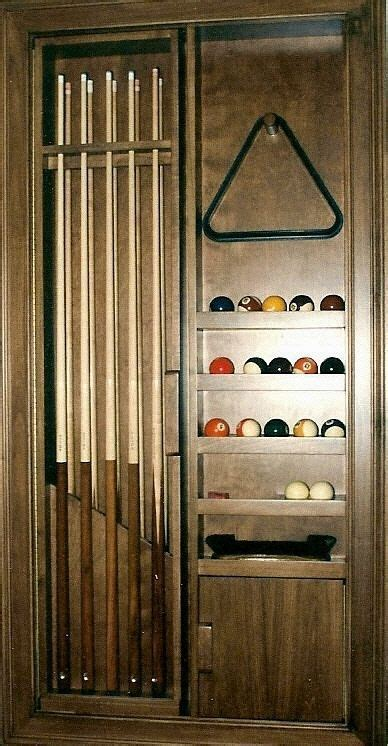 Recessed pool cue cabinet made out of birch.   Living
