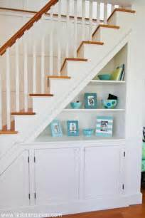 Mix the shelving and cabinets for more extra storage under the stairs