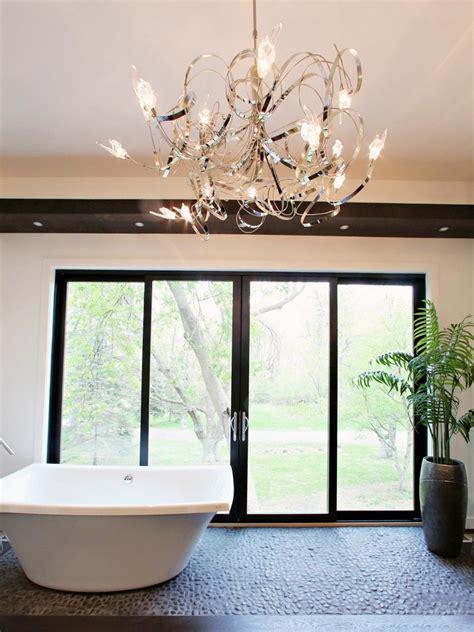 luxurious bathrooms with chandelier lighting