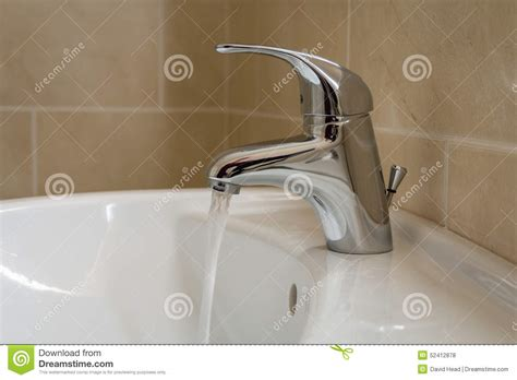 No Water In Shower But Water In Sink by Bathroom Sink Tap With Running Water Stock Photo Image