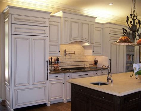 kitchen cabinet range hood design view of fridge range area traditional kitchen