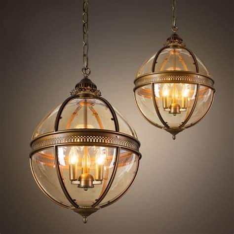 globe chandelier globe chandelier noir qs pluto chandelier in antique brass