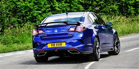 vauxhall blue vauxhall vxr8 gts r poses in blue