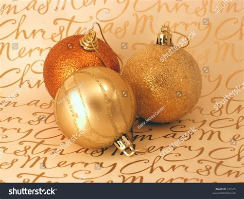 decorative bronze balls three bronze and gold christmas decorative balls on merry