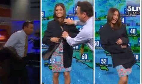 news reporter wardrobe malfunction news anchor saves weather girl after wardrobe malfunctiion