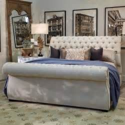 this chic upholstered sleigh bed features a luxurious