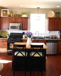 decorating ideas for top of kitchen cabinets top 25 best over cabinet decorating ideas on pinterest