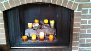 flameless candles for a cozy fireplace decorating ideas