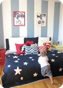 House of giggles a red yellow and blue striped shared boys bedroom