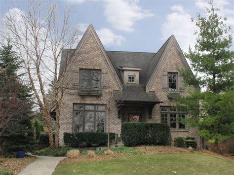 tudor style house house plan 2017 bath brick tudor style home sits meticulously landscaped