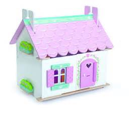 dolls house with furniture and doll family personalised wooden dolls house by harmony at home children s eco boutique