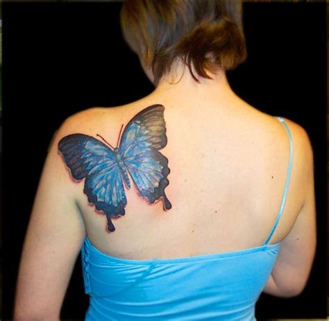 butterfly tattoo playing peekaboo on your back 40 amazing 3d tattoo designs of 2013 in vogue