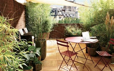 floor protectors for plants balcony privacy ideas with bamboo plants and reed mats