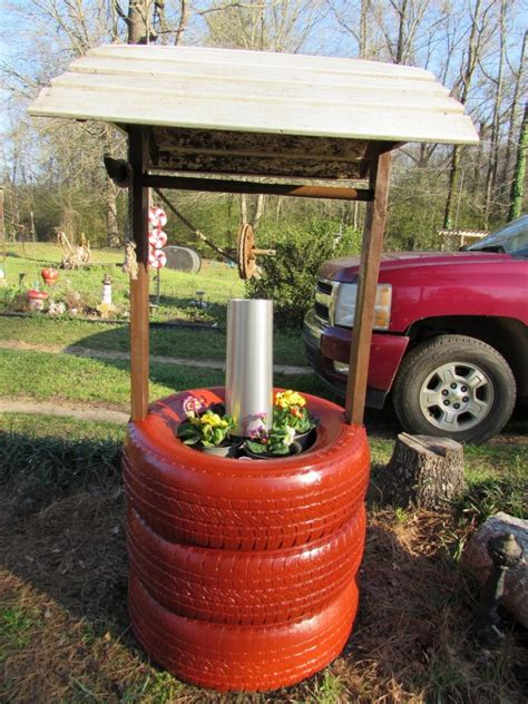 wishing well planter made from recycled tires the owner