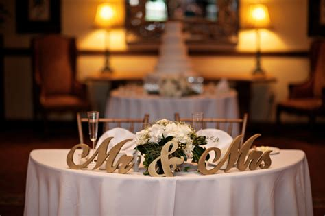 gold mr and mrs table sign elegant wedding reception setup for classic florida nups