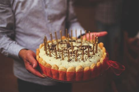 birthday cake  mens hands  stock photo