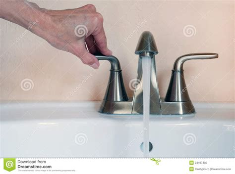 turn water sink turning on faucet royalty free stock photo image 24497405