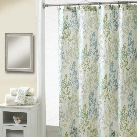 spring shower curtains delicate lacey leaves are printed in teal upon a textured