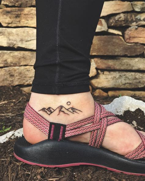mountain tattoo on foot 25 best ideas about mountain tattoos on