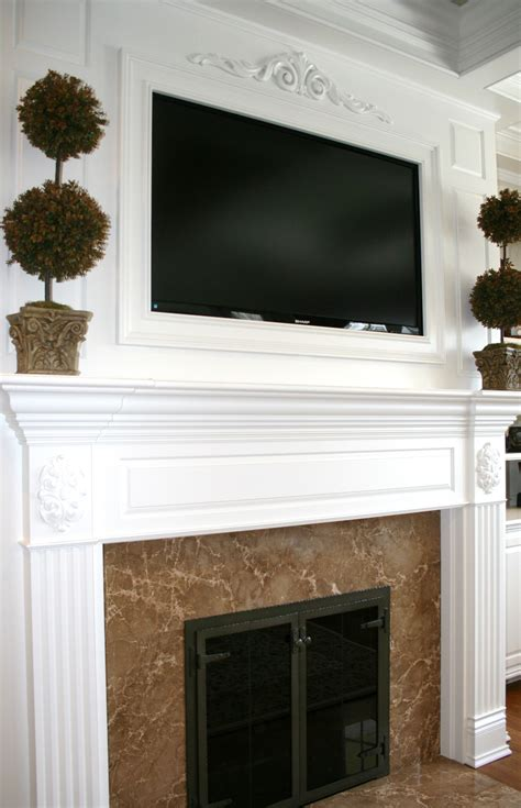 tv above fireplace mantel built by homes inc
