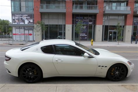 maserati toronto a sunset fancy car and possibly the best bike ever