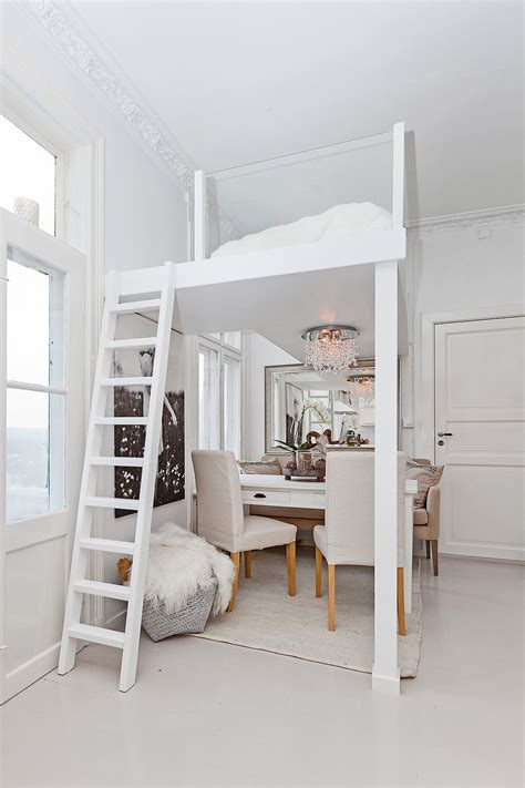 bed and living this loft bed with glass railings lets the light through