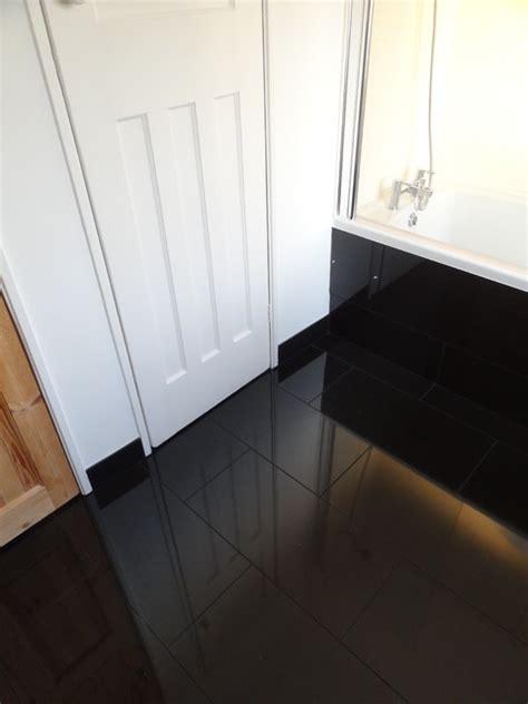 reflection of woodwork in gloss black porcelain tiles