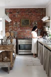 brick wall in kitchen roses and rust french and simple