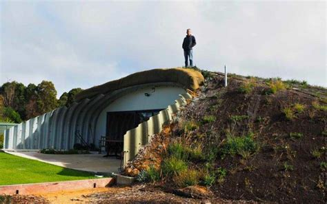 earth homes now underground berm rammed sheltered houses this earth sheltered australian hobbit home stays cozy all