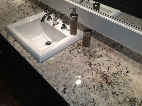 pictures of white granite bathroom countertops delicatus white granite counter in master bathroom traditional bathroom birmingham by